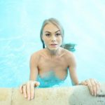 Blonde Enjoys Solo Play in a Pool